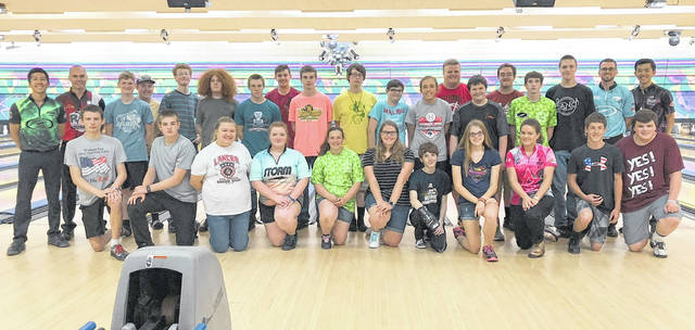 Youth campers and the professional bowlers and instructors at the Royal Z Lanes youth bowling camp.