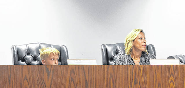 """While Councilmember Michael Allbright was absent from Thursday's Wilmington City Council meeting, Chase Fickert, left, """"filled in"""" for him next to his mom, Councilmember Kristi Fickert."""