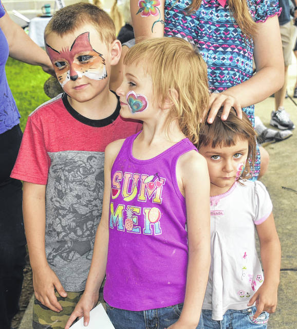 From left, siblings Collin, Molly and Abigil Shankland got their faces painted by their mom, Michelle, at her booth during the Art & Soul Festival on Saturday in Wilmington. For more photos, visit wnewsj.com.