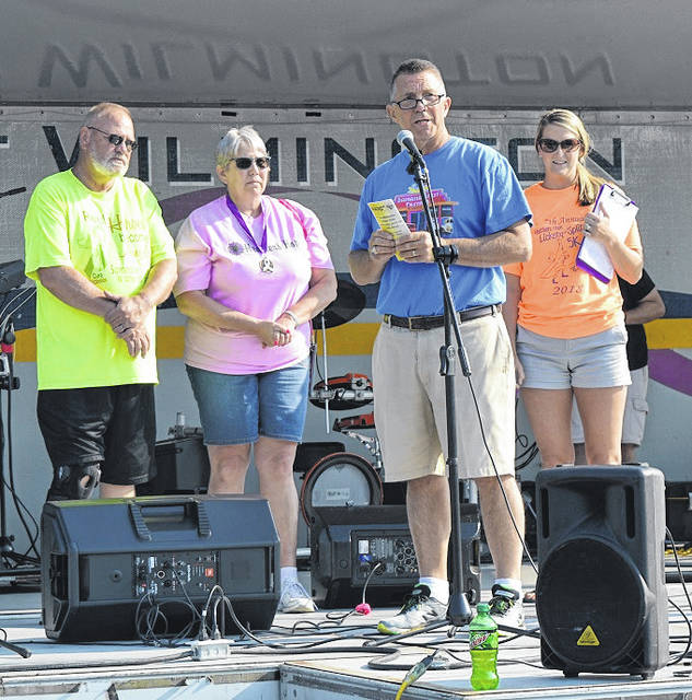 Wilmington Rotary's Jack Powell recognizes Richard and Gretchen James prior to the start of the Heather's Hope Lickety Split 5K event, named for the James' late daughter Heather.