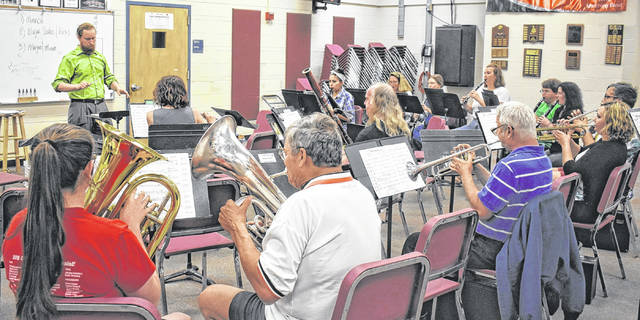 Eric Stanton takes the podium for the first time as Director of the Clinton County Community Band at their first practice on Tuesday evening. The group is open to anyone who wishes to join. Practices are 7:30-9 p.m. every Tuesday in the Wilmington High School band room. Those interested can contact Stanton at 937-218-2604 for more information.