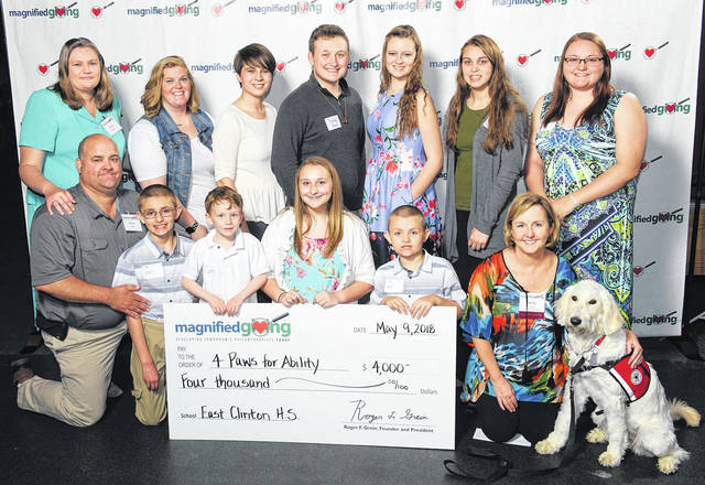 From left are: Front, Andy Roosa, Austin Roosa, Crosley Curtis, Tessa Bosier, Alex Roosa, and Kelly Camm, the 4 Paws for Ability Representative, along with service dog Moana; back, Amy Roosa, Casey Curtis, Mikala Runk, Trysten Bosier, Jazmin Carrico, Gracie Boggs, and Andrea Roosa-Kier.