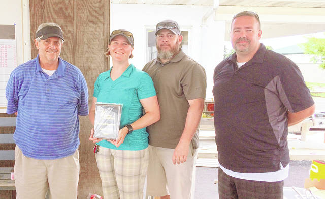 The Alkermes team finished as runnersup in the Harvest of Gold golf tournament. Team members are, from left to right, Mark Thompson, Gwen Hillberg, Don Merriman and Joe Cordy.