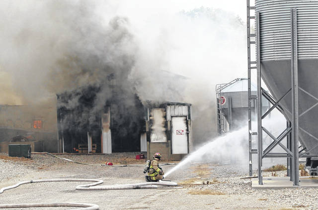 Firefighters from five counties battled a large fire Tuesday that killed 5,000 hogs at a hog facility in Wayne Township.