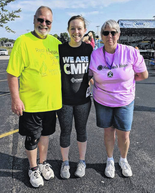 CMH's Kelsey Swindler, middle, with Richard and Gretchen James at the Heather's Hope Lickety Split 5K.