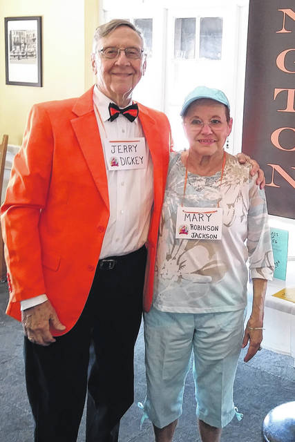 From left are Class Vice President Dr. Jerry Dickey and Treasurer Mary Robinson Jackson. Not only is Dickey wearing an orange sports jacket and black slacks, his bow tie is also the school colors of orange and black.