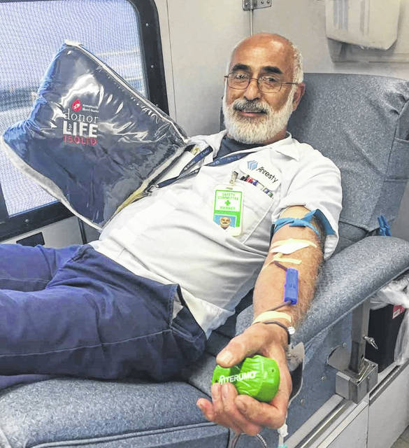 Ahresty's Fadi Al-Ghawi with his gift for achieving 150 units donated.