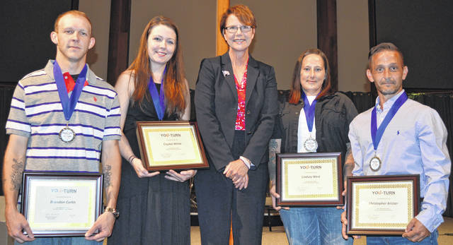 From left, You-Turn Recovery Docket graduates Brandon Curtis and Crystal White, Ohio Supreme Court Justice Sharon L. Kennedy, and You-Turn graduates Lindsey West and Christopher Bricker.