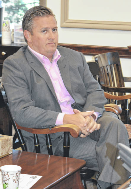 Assistant Clinton County Prosecuting Attorney Andrew McCoy, who is county government's legal counsel, meets with Clinton County commissioners Wednesday.