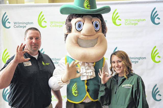 """Meeting the mascot, Quakerman, was a highlight of Wilmington College's Summer Orientation Wednesday for Caitlin Miner, a Wilmington resident and graduate of Clinton-Massie High School, who also is pictured flashing the """"WC sign"""" with her admission representative, Steve Cukovecki. She, along with other new students and their parents, spent the day learning about everything from academic policies, procedures and support services to the student code of conduct and the financial aid/billing process. Also, specially focused sessions were held for prospective student-athletes, commuter students and those planning to reside on campus. The day's orientation activities are designed to help students and parents navigate the college experience and for new students to hit the ground running when they arrive in August. Future Summer Orientation days for the rest of the entering class will be held in mid-July and early August."""