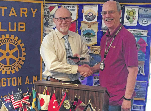 Tony Talbott, left, with A.M. Rotary President Chuck Watts.