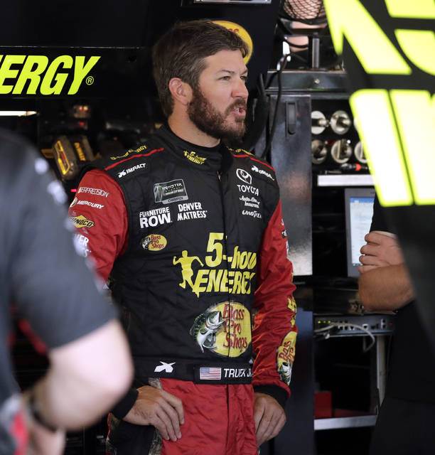 Martin Truex Jr., talks to his crew in his garage during a practice session for the NASCAR Cup Series auto race at Chicagoland Speedway in Joliet, Ill., Saturday, June 30, 2018. (AP Photo/Nam Y. Huh)