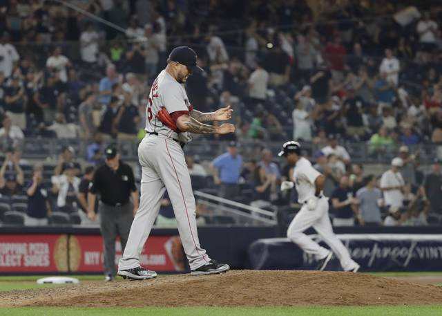 Boston Red Sox starting pitcher Hector Velazquez (76) reacts as New York Yankees' Aaron Hicks (31) runs the bases after hitting a home run during the eighth inning of a baseball game Sunday, July 1, 2018, in New York. (AP Photo/Frank Franklin II)