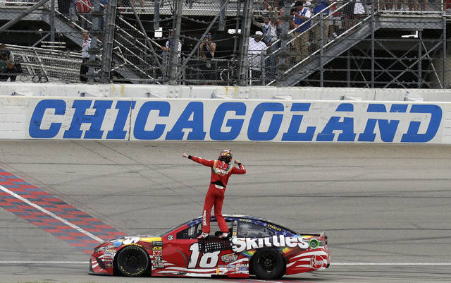 Kyle Busch celebrates after winning a NASCAR Cup Series auto race at Chicagoland Speedway in Joliet, Ill., Sunday, July 1, 2018. (AP Photo/Nam Y. Huh)