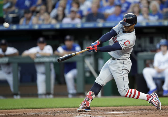 Cleveland Indians' Francisco Lindor hits a grand slam off Kansas City Royals starting pitcher Jakob Junis during the fourth inning of a baseball game at Kauffman Stadium in Kansas City, Mo., Monday, July 2, 2018. (AP Photo/Orlin Wagner)