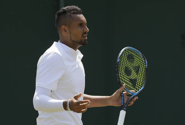 Nick Kyrgios of Australia questions a line call during the men's singles match against Denis Istomin of Uzbekistan on the second day at the Wimbledon Tennis Championships in London, Tuesday July 3, 2018. (AP Photo/Kirsty Wigglesworth)