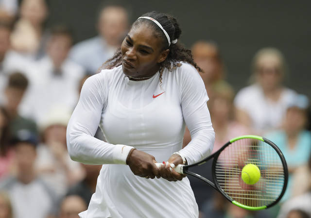 Serena Williams of the United States returns the ball to Bulgaria's Viktoriya Tomova during their women's singles match, on the third day of the Wimbledon Tennis Championships in London, Wednesday July 4, 2018. (AP Photo/Kirsty Wigglesworth)