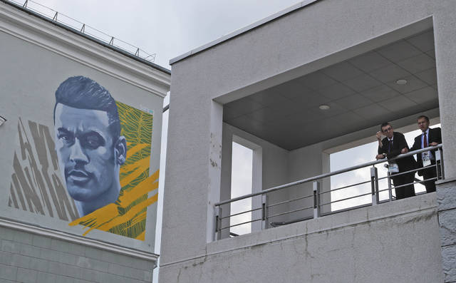 Artists painted a huge portrait of Brazil soccer player Neymar on the wall of a house opposite the Brazil team hotel during the 2018 soccer World Cup in Kazan, Russia, Thursday, July 5, 2018. (AP Photo/Frank Augstein)