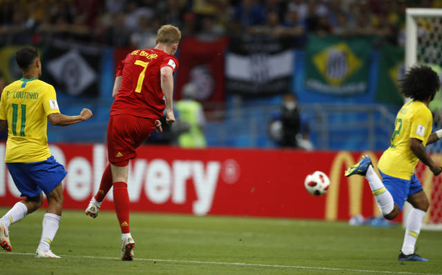 Belgium's Kevin De Bruyne scores his side's second goal during the quarterfinal match between Brazil and Belgium at the 2018 soccer World Cup in the Kazan Arena, in Kazan, Russia, Friday, July 6, 2018. (AP Photo/Francisco Seco)