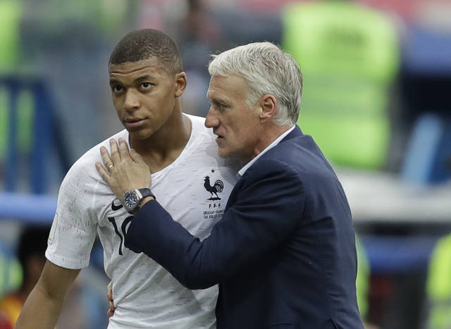 France's Kylian Mbappe, left, is embraced by France head coach Didier Deschamps as he leaves the pitch during the quarterfinal match between Uruguay and France at the 2018 soccer World Cup in the Nizhny Novgorod Stadium, in Nizhny Novgorod, Russia, Friday, July 6, 2018. (AP Photo/Natacha Pisarenko)