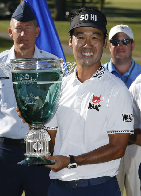 Kevin Na holds the trophy after winning the Military Tribute PGA Tour Golf Tournament at the Greenbrier in White Sulphur Springs, W. Va., Sunday, July 8, 2018. (AP Photo/Steve Helber)
