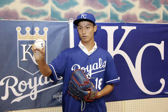 CORRECTS DATE - In this July 8, 2018 photo, Kaito Yuki poses for photographers at a press conference in Osaka, western Japan. Yuki is headed to the Kansas City Royals organization instead of attending high school in Japan. The team signed Yuki, a 16-year-old pitcher, out of junior high to a standard seven-year minor league contract Sunday. He is thought to be the first Japanese junior high school player to sign with a major league club. (Kyodo News via AP)