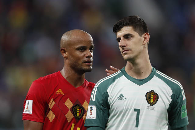 Belgium's Vincent Kompany, left, and Belgium goalkeeper Thibaut Courtois leave the field after the semifinal match between France and Belgium at the 2018 soccer World Cup in the St. Petersburg Stadium in, St. Petersburg, Russia, Tuesday, July 10, 2018. (AP Photo/Frank Augstein)