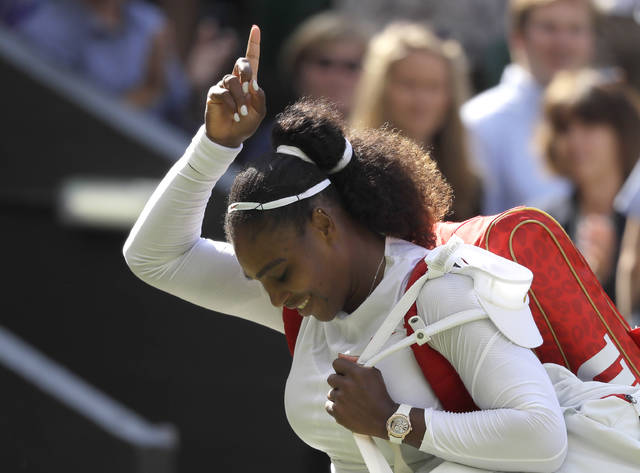 Serena Williams of the United States celebrates winning her women's singles quarterfinals match against Italy's Camila Giorgi, at the Wimbledon Tennis Championships, in London, Tuesday July 10, 2018. (AP Photo/Kirsty Wigglesworth)