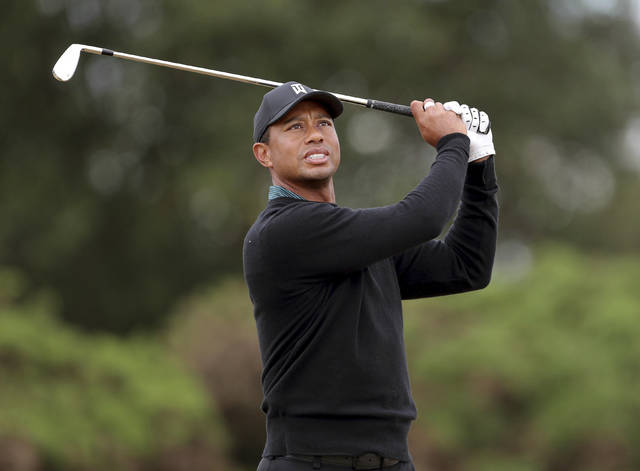 Tiger Woods of the US in action during preview day two of The Open Championship 2018 at Carnoustie Golf Links in Angus, Scotland, Monday July 16, 2018. (Richard Sellers/PA via AP)