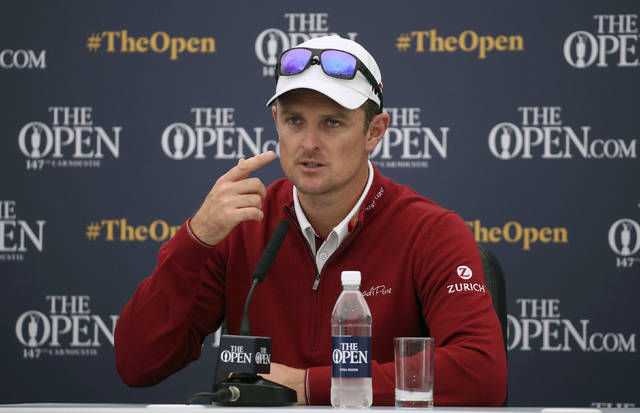 "England's Justin Rose speaks during a press conference on preview day three of The Open Championship 2018 at Carnoustie Golf Links, Angus, Scotland, Tuesday, July 17, 2018. Justin Rose's best finish at a British Open remains his tie for fourth at Royal Birkdale in 1998, when he was an amateur. He doesn't understand why. Rose says ""I'm kind of comfortable with how bad my record's been here ... and I don't feel like there's a reason for it either."" (Jane Barlow/PA via AP)"
