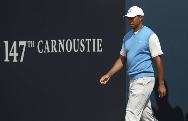 Tiger Woods of the US arrives at the 1st tee box during the first round of the British Open Golf Championship in Carnoustie, Scotland, Thursday July 19, 2018. (AP Photo/Jon Super)