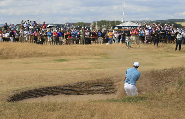 Jordan Spieth of the US hits out of a bunker on the 15th hole during the first round of the British Open Golf Championship in Carnoustie, Scotland, Thursday July 19, 2018. (AP Photo/Jon Super)