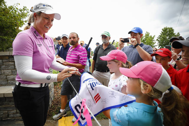 Brittany Lincicome signs autographs for fans following the second round of the PGA Tour's Barbasol Championship golf tournament at Keene Trace Golf Club in Nicholasville, Ky., Saturday, July 21, 2018. (Alex Slitz/Lexington Herald-Leader via AP)