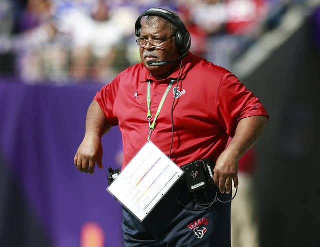 FILE - In this Oct. 9, 2016, file photo, Houston Texans defensive coordinator Romeo Crennel watches his team play the Minnesota Vikings during an NFL football game in Minneapolis. Crennel is back as defensive coordinator in Houston, replacing new Titans coach Mike Vrabel. (Jeff Haynes/AP Photo, File)