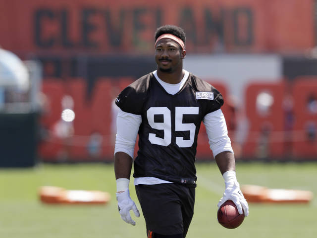 Cleveland Browns defensive end Myles Garrett walks on the field at the NFL football team's training camp facility, Thursday, July 26, 2018, in Berea, Ohio. (AP Photo/Tony Dejak)