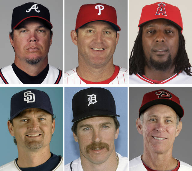 FILE - These are players being inducted into the Baseball Hall of Fame on Sunday, July 29, 2018. Top row from left are Chipper Jones, James Thome and Vladimir Guerrero. Bottom row from left are Trevor Hoffman, Jack Morris and Alan Trammell. (AP Photo/File)