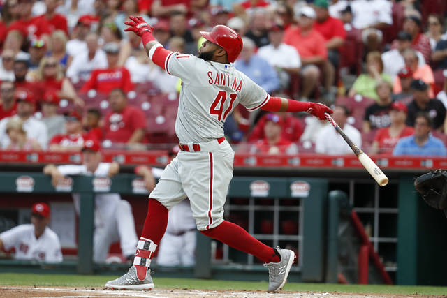 Philadelphia Phillies' Carlos Santana watches his two-run home run off Cincinnati Reds starting pitcher Tyler Mahle during the first inning of a baseball game Thursday, July 26, 2018, in Cincinnati. (AP Photo/John Minchillo)
