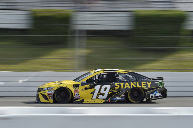 Daniel Suarez drives down the front stretch during qualifying for Sunday's NASCAR Cup Series auto race, Saturday, July 28, 2018, in Long Pond, Pa. Suarez advanced to the pole position after Kevin Harvick and Kyle Busch failed tech inspection after qualifying. (AP Photo/Derik Hamilton)