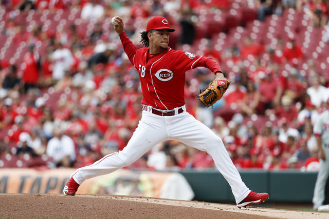 Cincinnati Reds starting pitcher Luis Castillo throws in the first inning of a baseball game against the Philadelphia Phillies, Sunday, July 29, 2018, in Cincinnati. (AP Photo/John Minchillo)