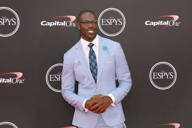 "FILE - In this July 18, 2018, file photo, former NFL player Terrell Owens arrives at the ESPY Awards in Los Angeles. Despite his decision to not attend Saturday's Pro Football Hall of Fame induction ceremonies, Terrell Owens will be ""honored"" by the hall for his NFL career. Hall President David Baker tells The Associated Press on Monday, July 30, 2018, that the Canton, Ohio, shrine's mission statement begins with the goal ""to honor the heroes of the game.""(Photo by Willy Sanjuan/Invision/AP, File)"