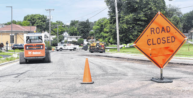 Library Avenue gets repaved in the hot summer sun this week — one of 24 streets in Wilmington's first ward getting repaved or crack sealing.