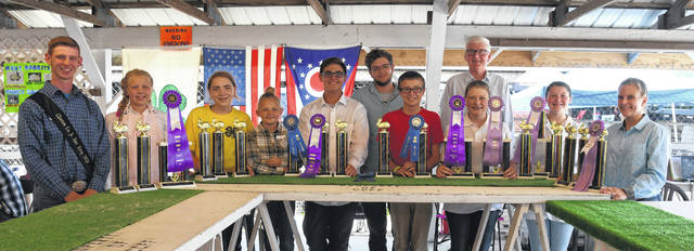 All the Rabbit Show trophy winners: From left are Ethan Dickey-Hall, Emily Goodwin, Carolyn Koch, Rose Hall, Jayden Doyle, Conner Cook (back), Eli Caldwell, Melanie Harner, Judge Dr. Chris Hayhow (back), Addison Beckett, and Morgan Wiget.