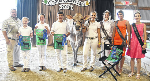 The Dairy Showmanship winners at the 2018 Clinton County Fair are among those pictured: From left are Judge Jeff Brown with COBA Select Sires, Overall Beginner Shelby Leaming, Overall Junior Nikita White, Overall Intermediate Ethan Gibson, Overall Senior who will be representing dairy in the Tony Grapevine sweepstakes Sarah Quallen, 2018 Dairy Princess Maggie Mathews, 2018 Lamb & Fleece Queen Gracie McCarren, and 2018 Junior Fair Queen Salesa Fyffe. For more fair photos, see inside and at wnewsj.com.