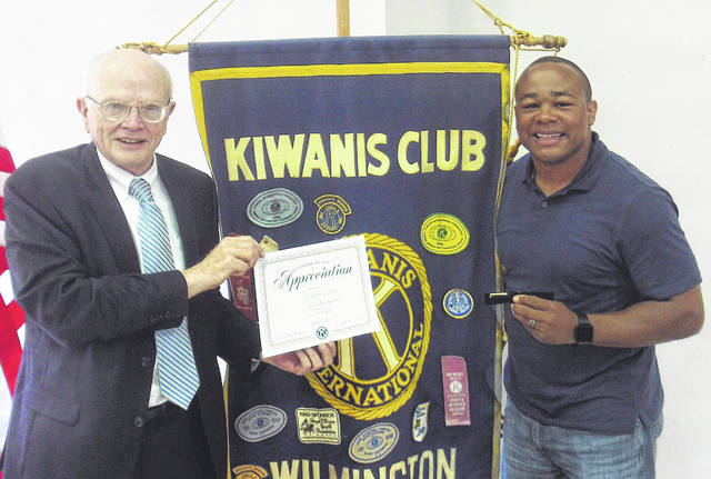 Guest speaker at the Thursday, July 19 Kiwanis Club meeting was Wilmington City Parks & Recreation Director Jermaine Isaac discussing the department's activities. Isaac spoke about the new project in replacing old playground equipment and how Kiwanis can help in reaching their fundraising goal for the new playground equipment. Shown, Kiwanis Club President Mack Fife presents Isaac with a certificate and Kiwanis pen.