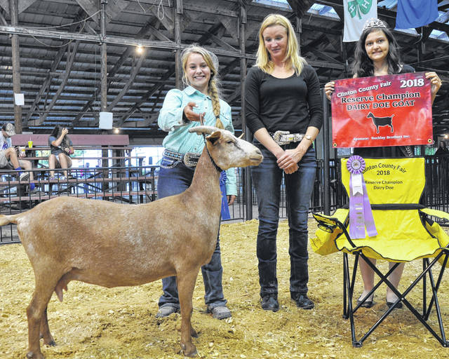 Reserve Champion Dairy Doe winner Abby Danku with Judge Christy Shearer and Queen Jillian Richardson.