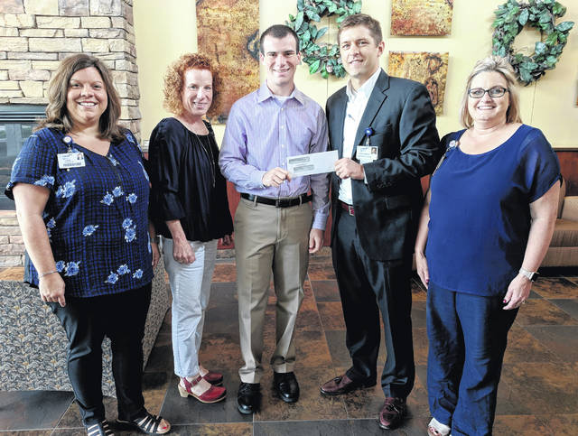 From left are Erin Morrow, President of Employee Engagement Board, Jill Reese, Zachary Reese, Lance Beus, CEO, and Brenna Eldridge, Director of Foster J. Boyd, MD Regional Cancer Center.