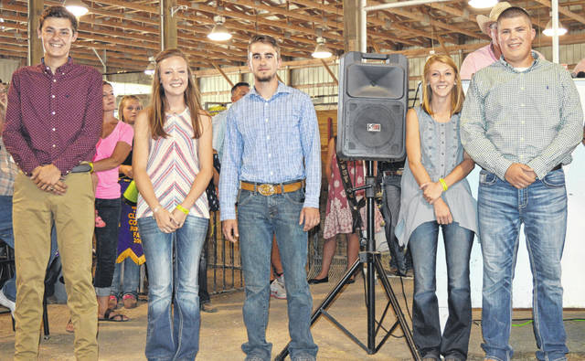 Five 4-H members earned Lois Boyer Scholarships in 2018, each receiving $500. From left in the foreground are Ridge Beam, Anne Thompson, Drew Houseman, Katie Hughes and Drew Moyer.