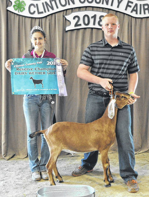 For Reserve Champion Dairy Dairy Wether, from left are Goat Queen Jillian Richardson, and winner Andrew Stewart.