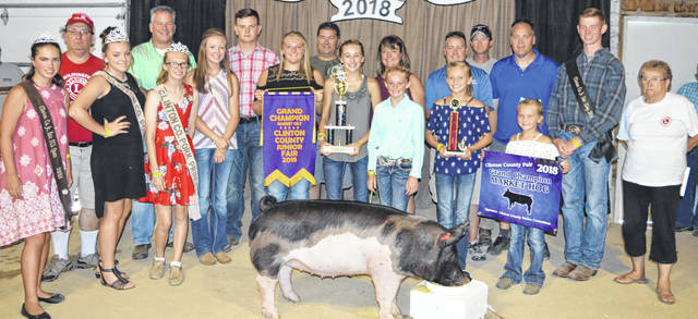 Ella Thompson's grand champion market hog brought a $4,975 premium at the Clinton County Junior Fair's Swine Sale. The buyers are Accurate Soils, AgriGold Hybrids, Air Transport International (ATI), Jody Ames D.D.S., Arehart-Brown Funeral Services LLC, BDK Feed & Supply, Baughman Farm Excavating LLC, Bush Auto Place, Dave Campbell Insurance, Caribou Sanitation, Cherrybend Pheasant Farm / Ellis Farms, Collett Farms / Pioneer Seeds, Country View Hospital (Dr. Jill Thompson), Troy and Marianne Diels Family, Farm Credit Services, Five Points Implements Co., Groves Tire & Service, JD Equipment Inc., Long's Pharmacy, Lowes, Bill Marine Ford, Martinsville Lions Club, Merchants National Bank, Nate Warner, Peoples Bank, R+L Carriers / Roberts Centre, R.D. Holder Oil, Service Master by Angler, Brady and Donna Snyder, Thompson Farms, Vital Fitness, Walker Farms, Wilmington Auto Center (Chrysler, Dodge, Jeep), Wilmington Lions Club, Wilmington Savings Bank, World Equestrian Center, Greater Tomorrow Health, No. 1 China Buffet, Murphy Farms, Campbell Co., MFA Inc., Keplinger Farms Showpigs, Drew Ag Farms, and Tro Go Amish Recipe Pretzels and Doughnuts.