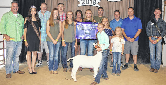 Ella Thompson's grand champion market goat brought a $3,325 premium at the Junior Fair Market Goat Sale held on the final day of the Clinton County Fair. The buyers are American Equipment Service, Jody Ames D.D.S., Bradshaw Trucking, Bush Auto Place, Dave Campbell Insurance, Caribou Sanitation, Cherrybend Pheasant Farm/Ellis Farms, Collett Farms/Pioneer Seeds, Country View Hospital (Dr. Jill Thompson), D and E Equipment Co., Diels Family, Farm Credit Services, Fisher-Edgington Funeral Home, Generations Pizzeria, Groves Tire & Service, JD Equipment 8 locations, Long's Pharmacy, Bill Marine Ford, Merchants National Bank, Peoples Bank, R+L Carriers / Roberts Centre, R.D. Holder Oil, Sunrise Cooperative, Thompson Farms, Walker Farms, Wilmington Auto Center (Chrysler, Dodge, Jeep), Wilmington Savings Bank, World Equestrian Center, No. 1 China Buffet, Murphy Farms, Campbell Co., MFA Inc., and Drew Ag Farms.